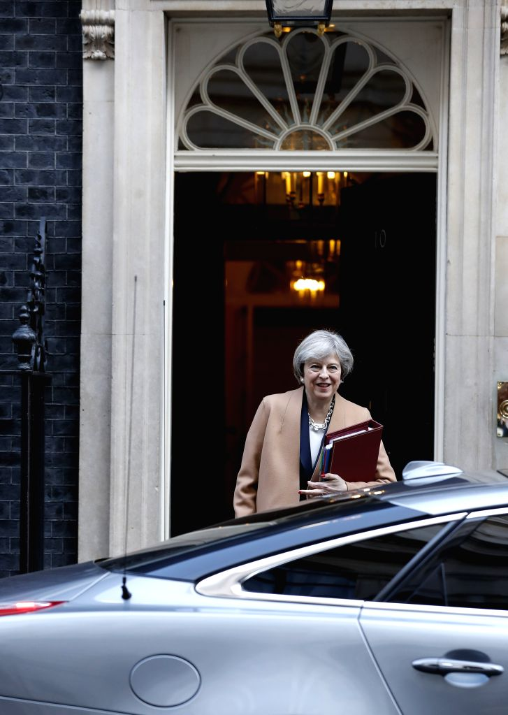 LONDON, March 15, 2017 - British Prime Minister Theresa May leaves 10 Downing Street for Prime Minister's Questions (PMQs) at the parliament in central London, Britain, on March 15, 2017. (Xinhua/Han ... - Theresa May