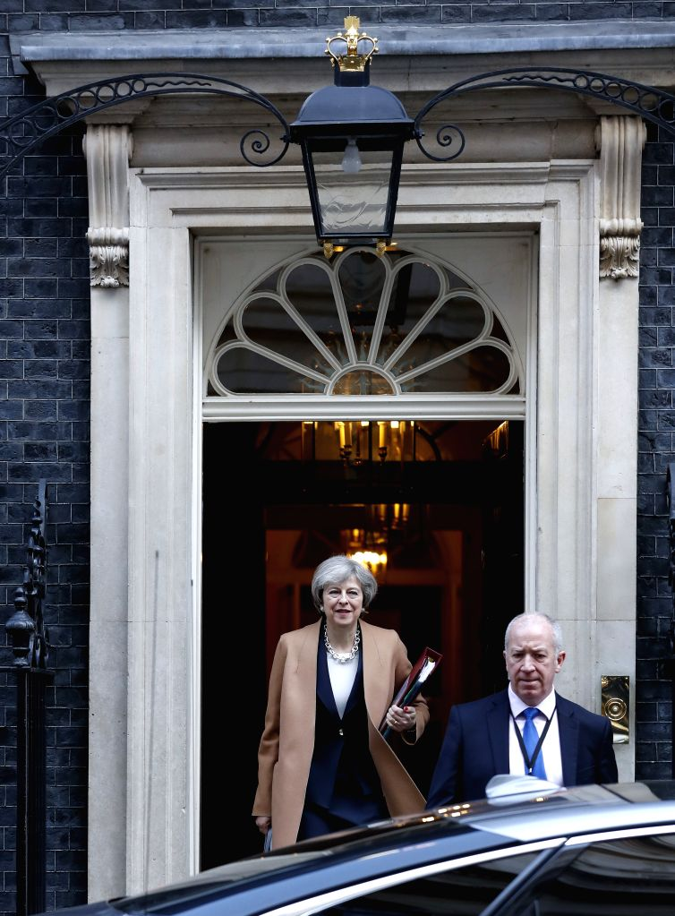 LONDON, March 15, 2017 - British Prime Minister Theresa May (L) leaves 10 Downing Street for Prime Minister's Questions (PMQs) at the parliament in central London, Britain, on March 15, 2017. ... - Theresa May
