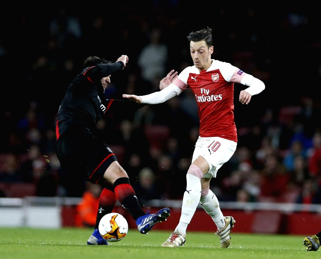 LONDON, March 15, 2019 - Mesut Ozil (R) of Arsenal is fouled by Clement Grenier of Rennes during the Europa League Round of 16 second Leg match between Arsenal and Rennes at the Emirates Stadium in ...