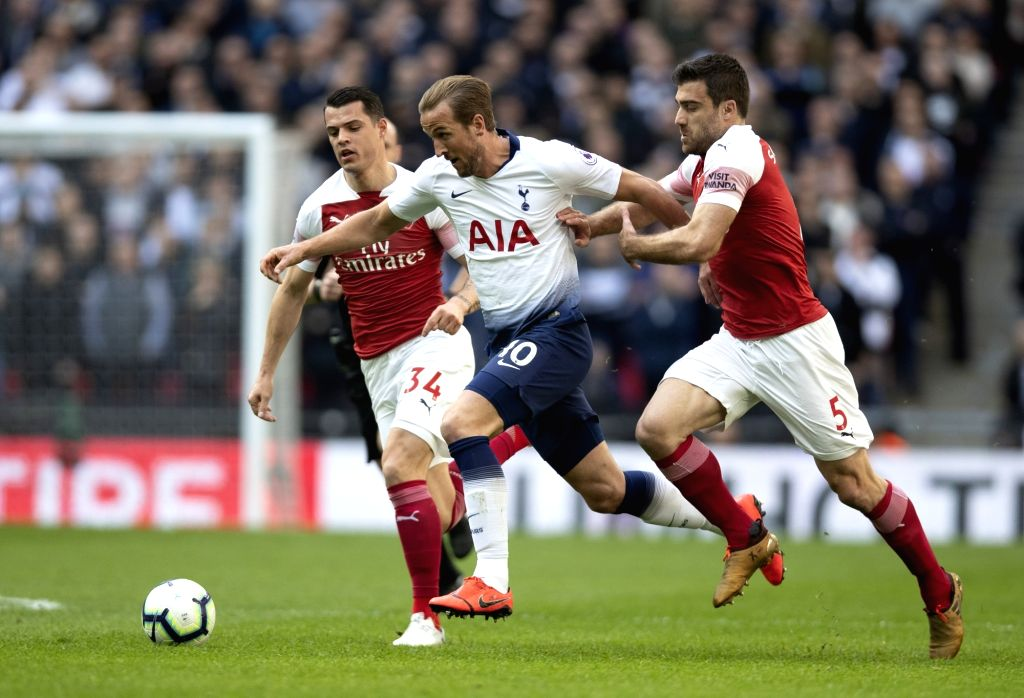 LONDON, March 2, 2019 - Tottenham Hotspur's Harry Kane (C) competes during the Premier League match between Tottenham Hotspur and Arsenal in London, Britain on March 2, 2019. FOR EDITORIAL USE ONLY. ...
