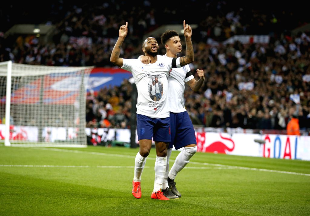 LONDON, March 23, 2019 (Xinhua) -- England's Raheem Sterling (L) celebrates scoring during the Euro 2020 qualifying Group A match between England and Czech Republic at Wembley Stadium in London, Britain on March 22, 2019. England won 5-0. FOR EDITORI
