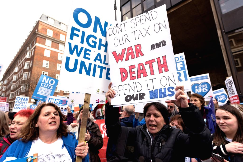 LONDON, March 5, 2017 - Supporters of the Britain's National Health Service (NHS) take part in a demonstration against budget cuts, closures and privatization in London, Britain on March 4, 2017. ...
