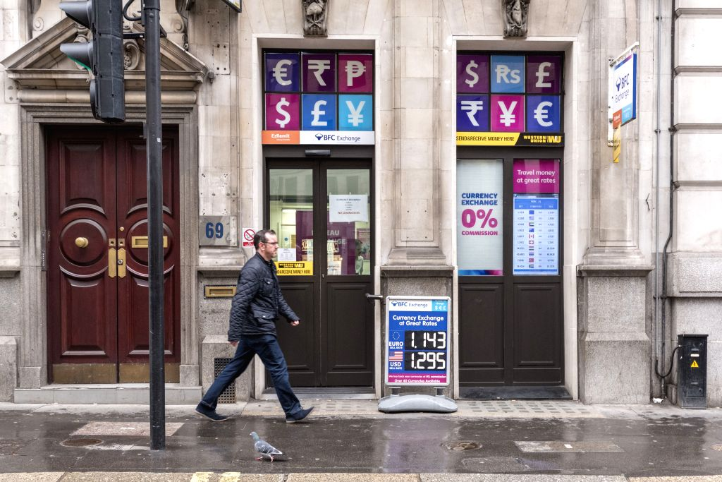 LONDON, March 7, 2019 - A man passes by a money exchange shop near the Bank of England in London, on March 6, 2019. As Britain is set to leave the European Union (EU) on March 29, UK Finance firms ...
