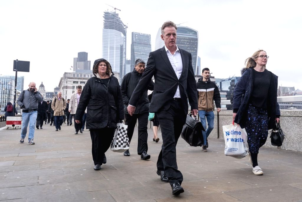 LONDON, March 7, 2019 - Commuters cross the London Bridge in London, on March 6, 2019. As Britain is set to leave the European Union (EU) on March 29, UK Finance firms have been preparing for a ...