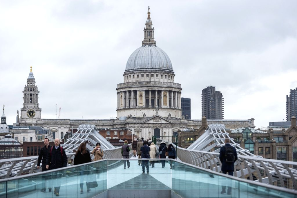 LONDON, March 7, 2019 - Office workers from financial institutions cross the Millennium Bridge, with St. Paul's Cathedral in the background, in London, on March 6, 2019. As Britain is set to leave ...