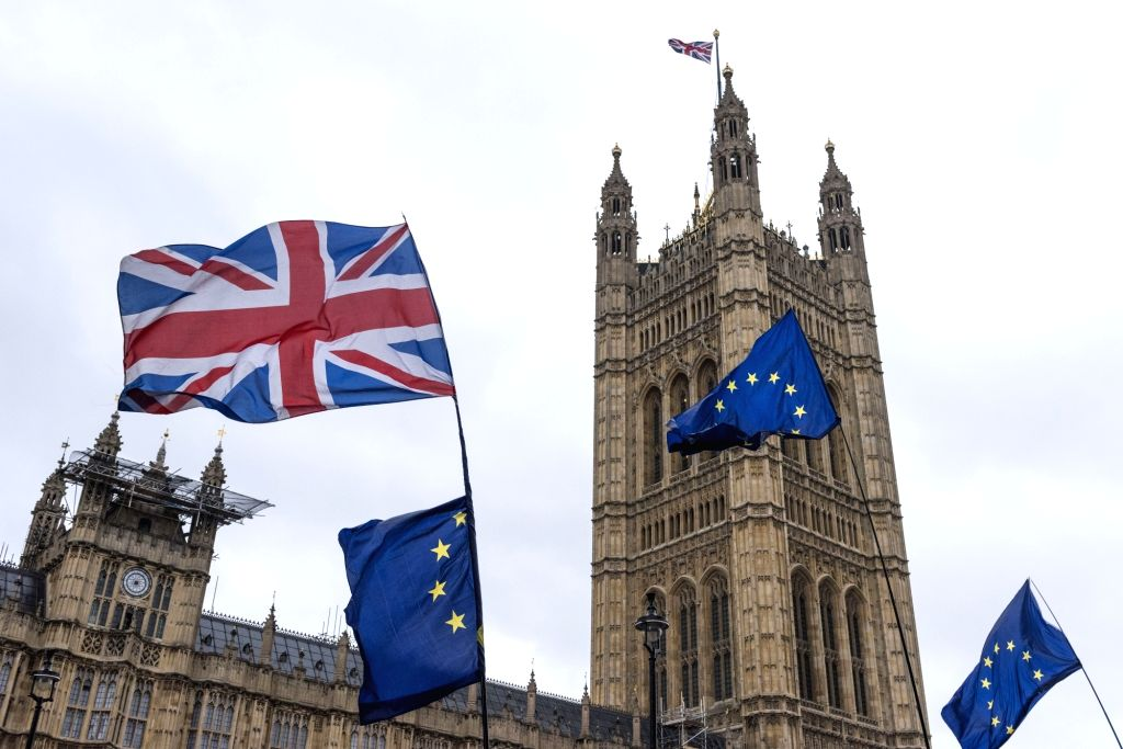 LONDON, March 7, 2019 - Photo taken on March 6, 2019 shows UK flags and European Union flags flying outside the Houses of Parliament in London. As Britain is set to leave the European Union (EU) on ...