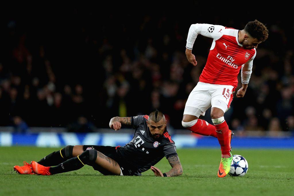 LONDON, March 8, 2017 - Arturo Vidal(L) of Bayern Munich vies with Alex Oxlade-Chamberlain of Arsenal during the UEFA Champions League Round of 16 second leg match between Arsenal and Bayern Munich ...