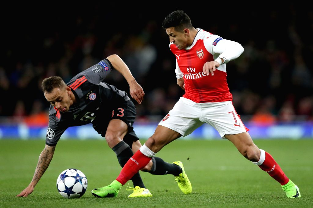 LONDON, March 8, 2017 - Rafinha(L) of Bayern Munich vies with Alexis Sanchez of Arsenal during the UEFA Champions League Round of 16 second leg match between Arsenal and Bayern Munich in London, ...