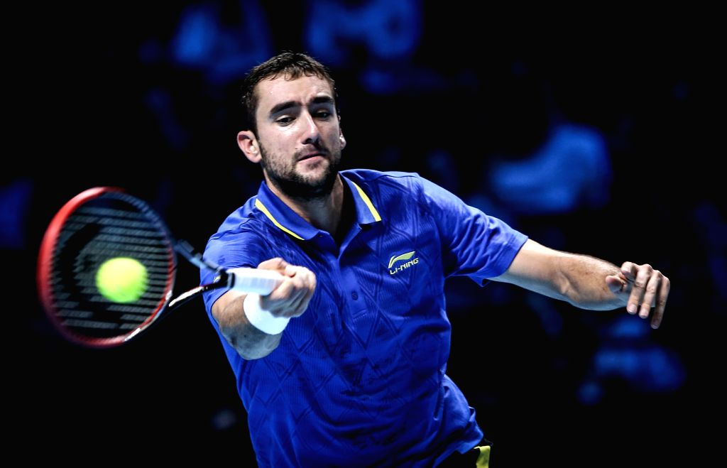 Marin Cilic of Croatia returns the ball during the ATP World Tour Finals Group match against Tomas Berdych of the Czech Republic in London, Britain, on Nov. 12, 2014. Cilic lost 0-2. ...