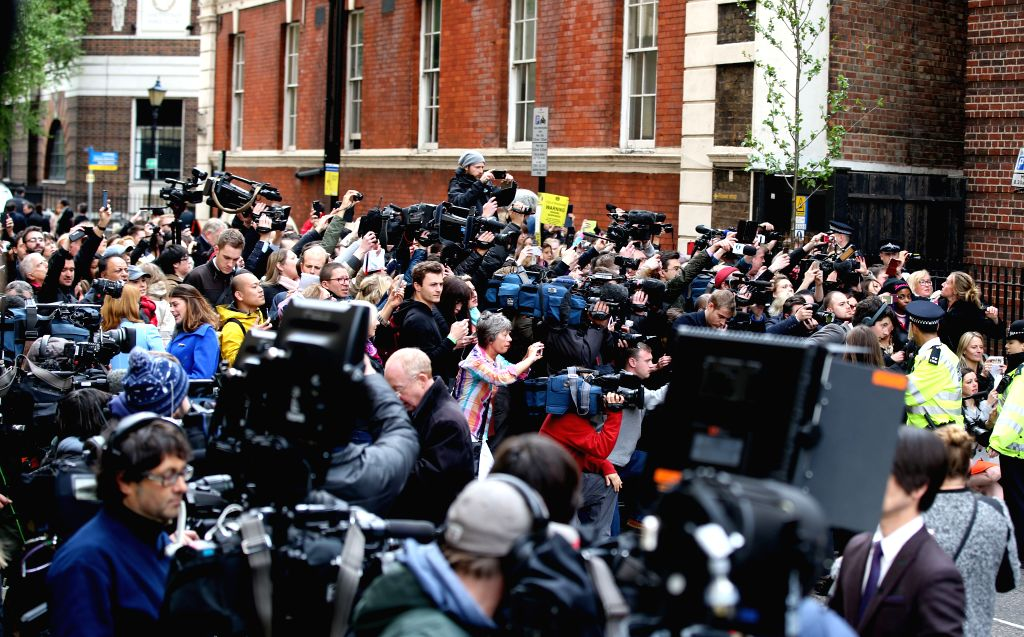 Royal fans and journalists gather outside St. Mary's Hospital in London, on May 2, 2015. Britain's Duchess of Cambridge Kate gave birth to a girl on Saturday morning, ...