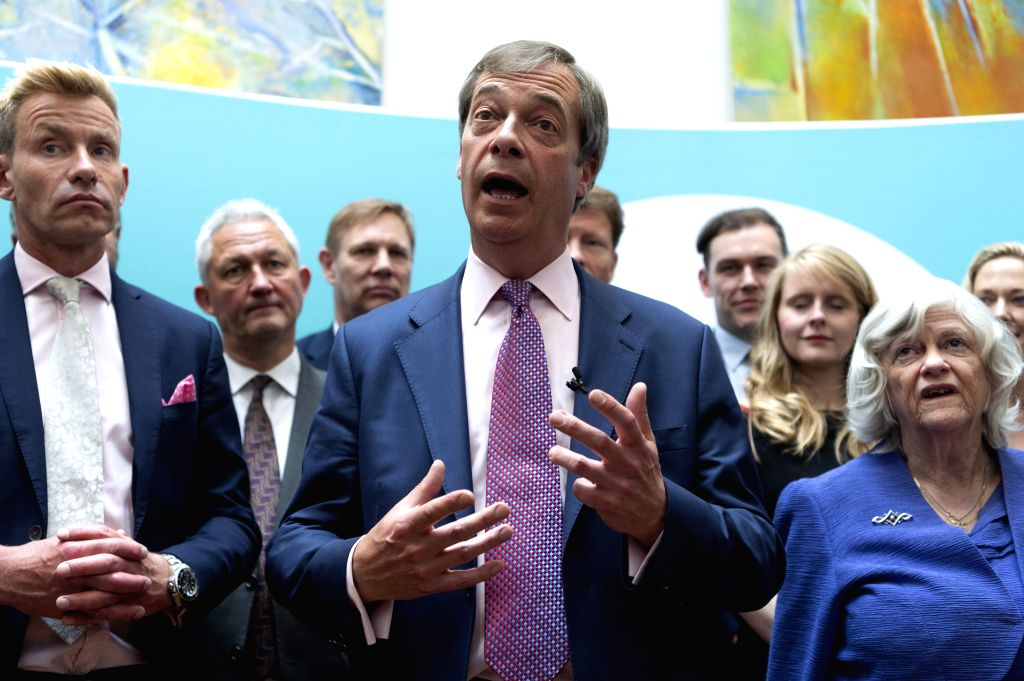 LONDON, May 27, 2019 - Brexit Party leader Nigel Farage (C) speaks to the media at a Brexit Party event in London, Britain, on May 27, 2019. It was the failure by both the Conservatives and Labour to ...