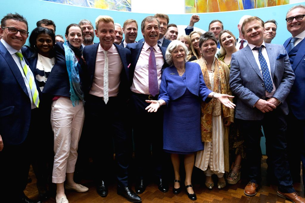 LONDON, May 27, 2019 - Brexit Party leader Nigel Farage (C) poses at a Brexit Party event in London, Britain, on May 27, 2019. It was the failure by both the Conservatives and Labour to resolve how ...
