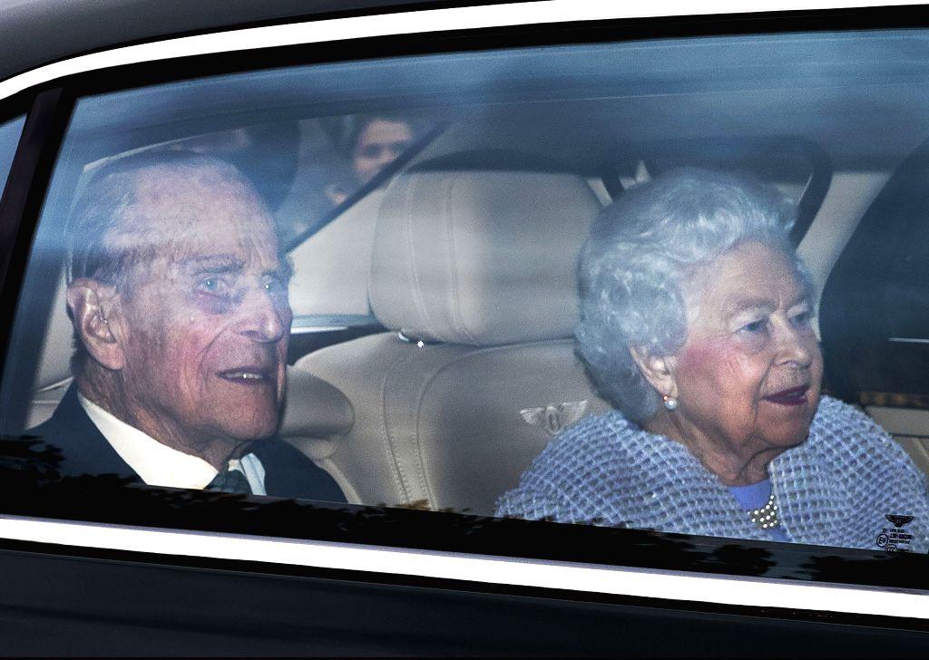 LONDON, May 4, 2017 - British Queen Elizabeth II and her husband Prince Philip (L), the Duke of Edinburgh, arrive back at Buckingham Palace in London, Britain, on May 4, 2017. British Queen Elizabeth ...