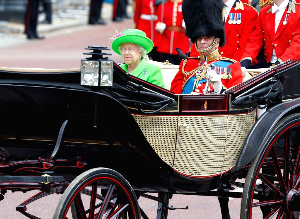LONDON, May 4, 2017 - British Queen Elizabeth II (L) and Prince Philip the Duke of Edinburgh are seen on a carriage to Buckingham Palace during the Queen's 90th birthday celebrations in London, ...