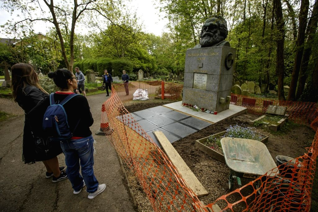 LONDON, May 4, 2018 - People view the tomb of Karl Marx, which is being renovated ahead of the 200th anniversary of his birth, at Highgate Cemetary, in London, Britain on May 3, 2018.