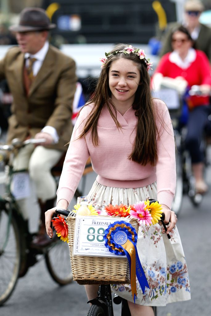 LONDON, May 7, 2017 - A lady wearing vintage clothing takes part in the annual Tweed Run bicycle ride in London, Britain, on May 6, 2017. (Xinhua/Han Yan)