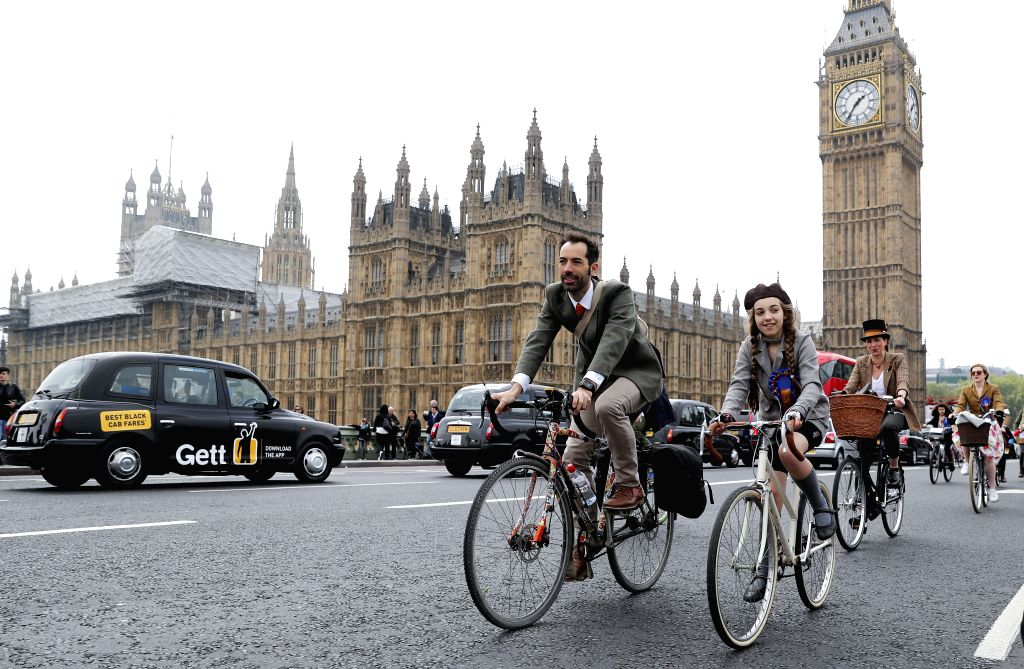 LONDON, May 7, 2017 - Cyclists wearing vintage clothings take part in the annual Tweed Run bicycle ride in London, Britain, on May 6, 2017. (Xinhua/Han Yan)