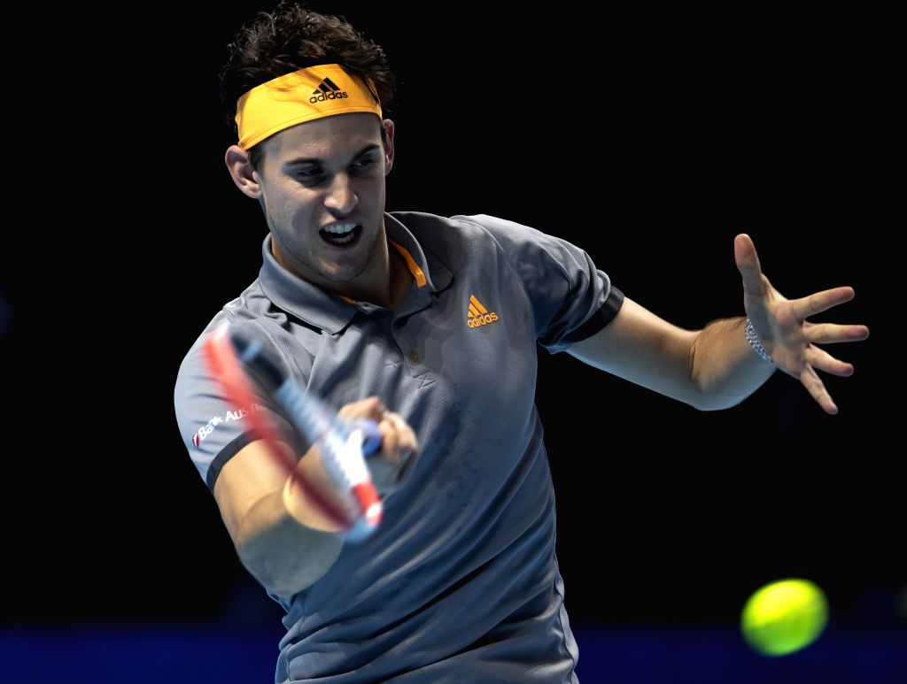 LONDON, Nov. 13, 2019 - Dominic Thiem of Austria returns a shot during the singles group match against Novak Djokovic of Serbia at the ATP World Tour Finals 2019 in London, Britain on Nov. 12, 2019.