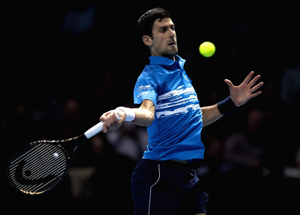 LONDON, Nov. 13, 2019 - Novak Djokovic of Serbia returns a shot during the singles group match against Dominic Thiem of Austria at the ATP World Tour Finals 2019 in London, Britain on Nov. 12, 2019.