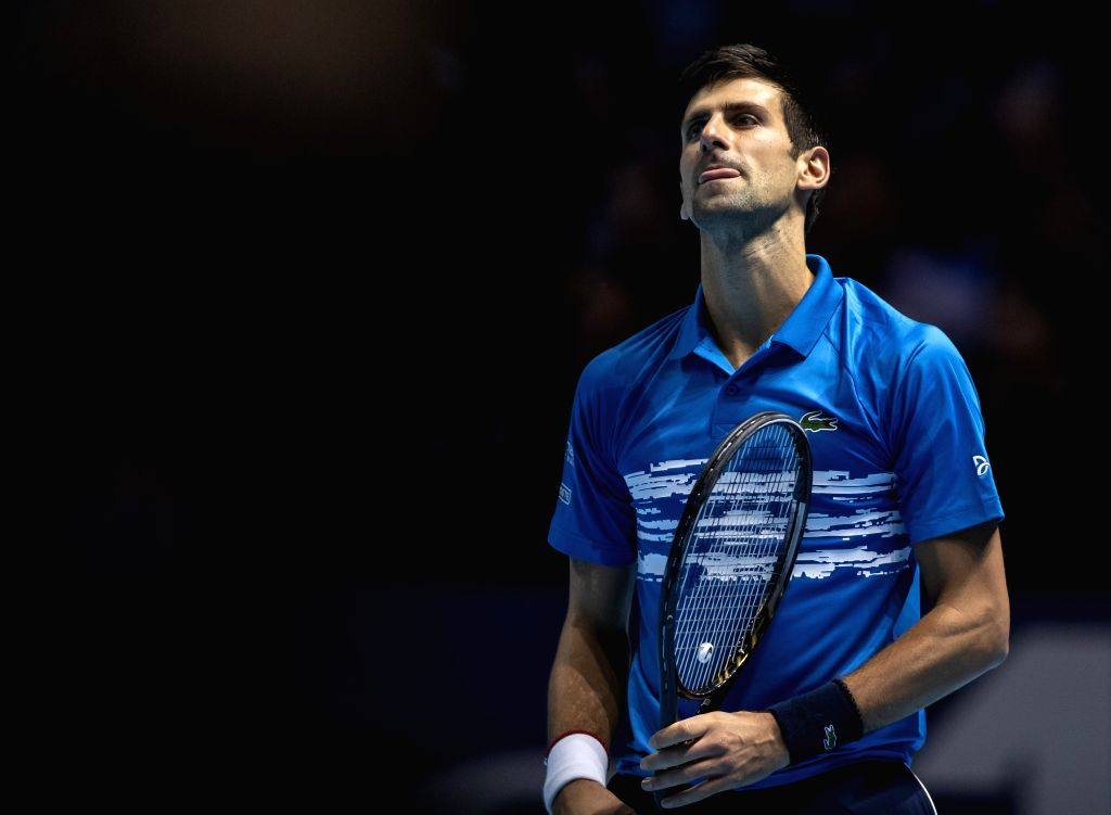LONDON, Nov. 13, 2019 - Novak Djokovic of Serbia reacts during the singles group match against Dominic Thiem of Austria at the ATP World Tour Finals 2019 in London, Britain on Nov. 12, 2019.