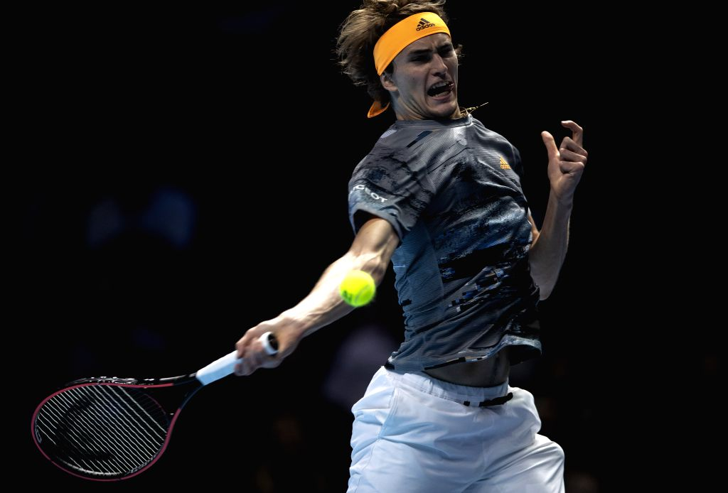 LONDON, Nov. 14, 2019 - Alexander Zverev of Germany returns a shot during the singles group match against Stefanos Tsitsipas of Greece at the ATP World Tour Finals 2019 in London, Britain on Nov. 13, ...