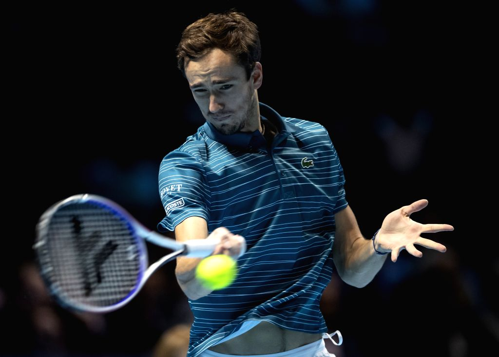 LONDON, Nov. 14, 2019 - Daniil Medvedev of Russia returns a shot during the singles group match against Rafael Nadal of Spain at the ATP World Tour Finals 2019 in London, Britain on Nov. 13, 2019.