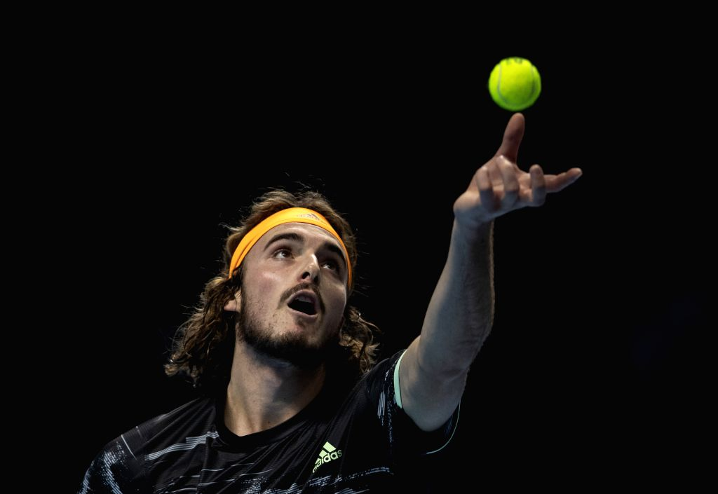 LONDON, Nov. 14, 2019 - Stefanos Tsitsipas of Greece serves during the singles group match against Alexander Zverev of Germany at the ATP World Tour Finals 2019 in London, Britain on Nov. 13, 2019.