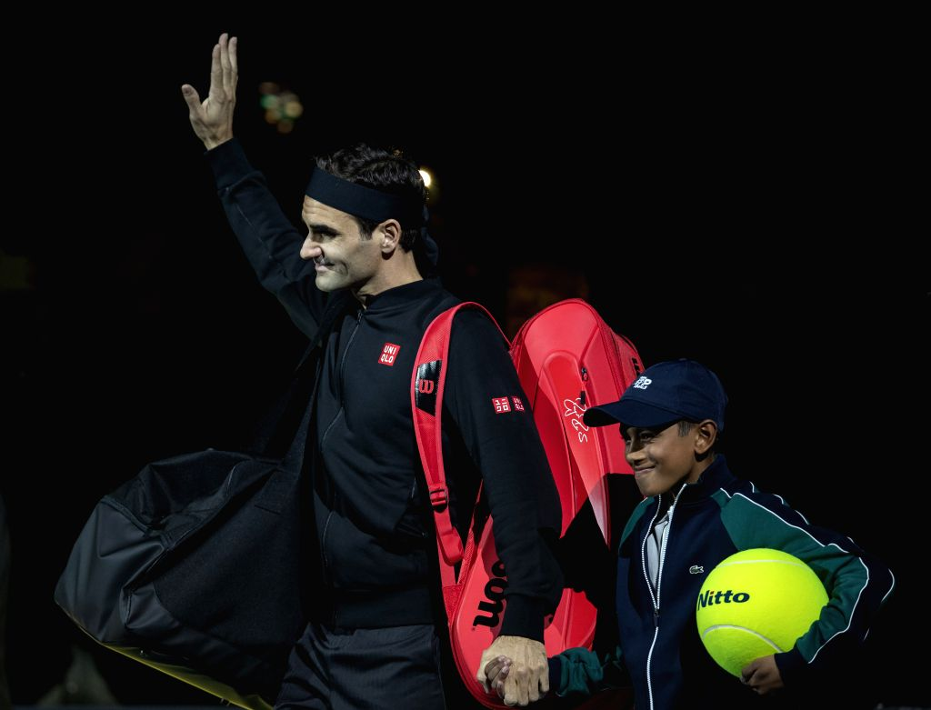 LONDON, Nov. 15, 2019 - Roger Federer (L) of Switzerland enters the court before the singles group match against Novak Djokovic of Serbia at the ATP World Tour Finals 2019 in London, Britain on Nov. ...