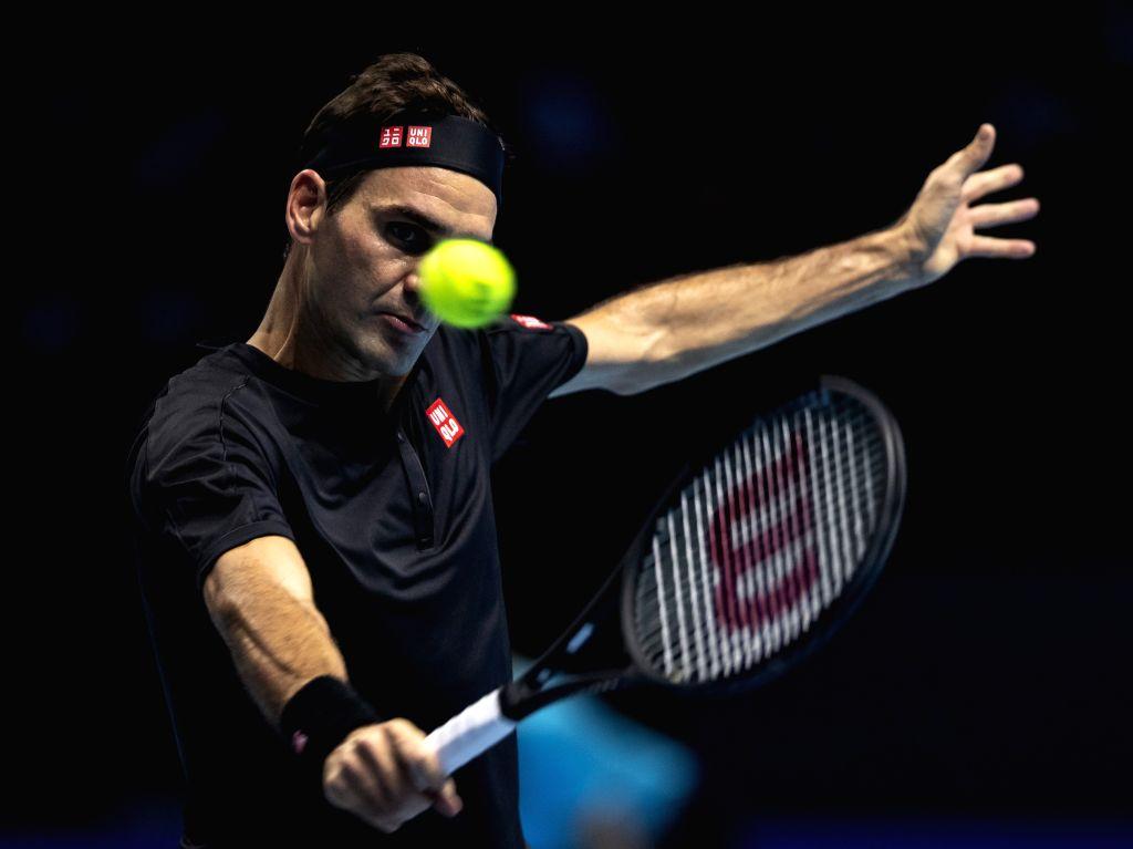 LONDON, Nov. 15, 2019 - Roger Federer of Switzerland returns a shot during the singles group match against Novak Djokovic of Serbia at the ATP World Tour Finals 2019 in London, Britain on Nov. 14, ...