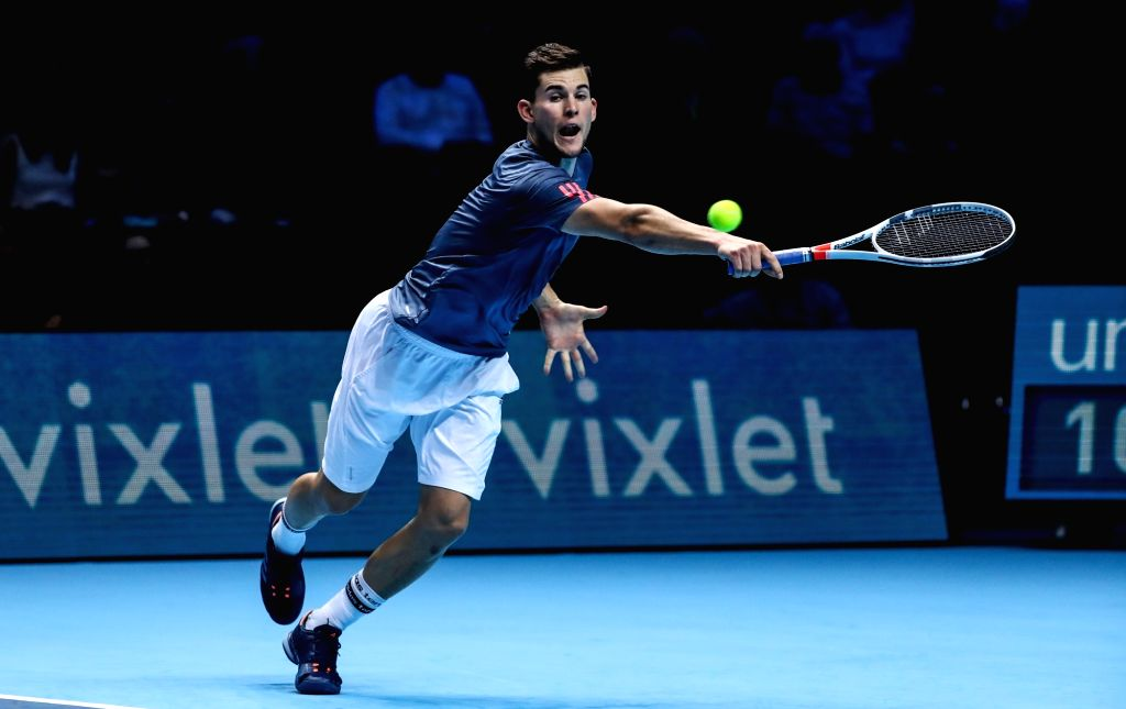 LONDON, Nov. 16, 2016 - Austria's Dominic Thiem returns against France's Gael Monfils during their round robin stage men's singles match on day three of the ATP World Tour Finals tennis tournament in ...