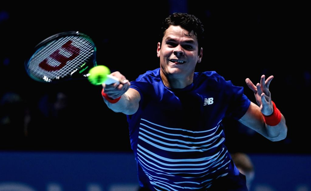 LONDON, Nov. 16, 2016 - Canada's Milos Raonic returns to Serbia's Novak Djokovic during their round robin stage men's singles match at the ATP World Tour Finals tennis tournament in London on Nov. ...