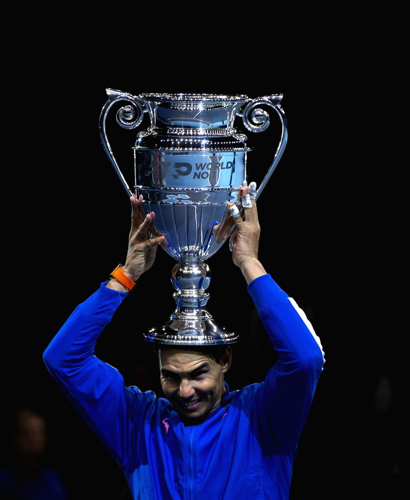 LONDON, Nov. 16, 2019 - Rafael Nadal of Spain lifts up his ATP World No. 1 trophy following the singles group match against Stefanos Tsitsipas of Greece at the ATP World Tour Finals 2019 in London, ...