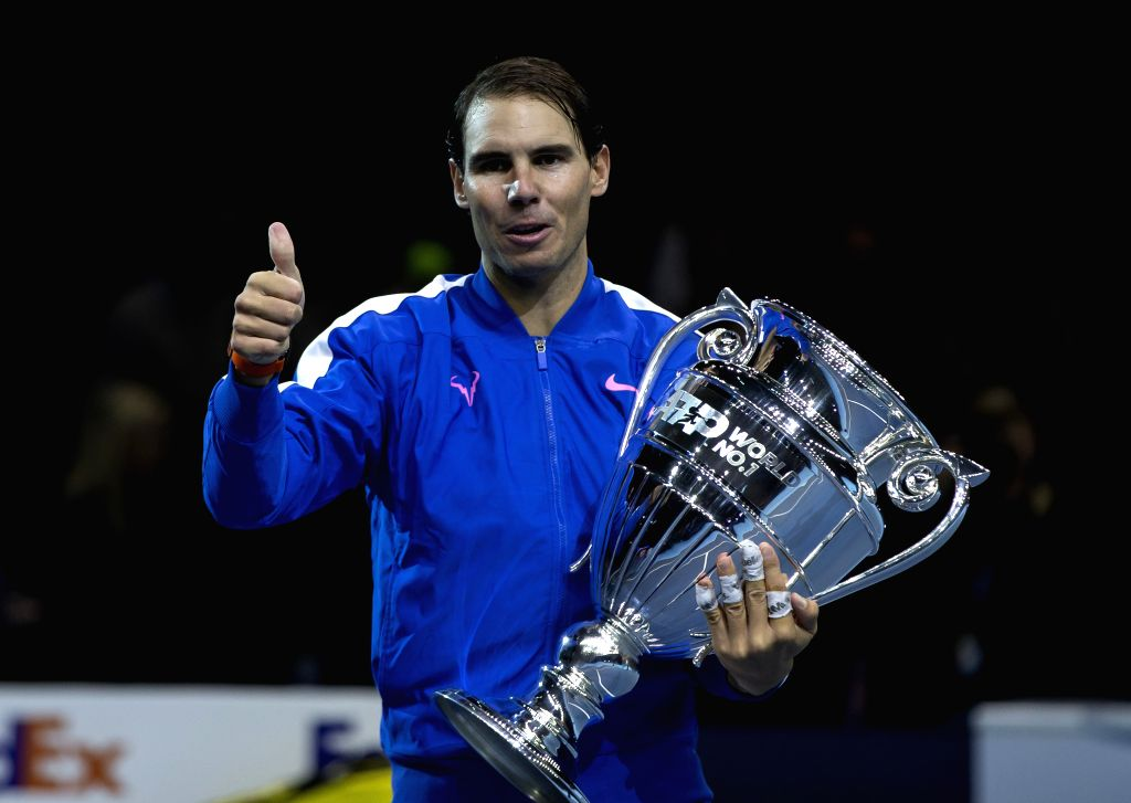 LONDON, Nov. 16, 2019 - Rafael Nadal of Spain poses with his ATP World No. 1 trophy following the singles group match against Stefanos Tsitsipas of Greece at the ATP World Tour Finals 2019 in London, ...