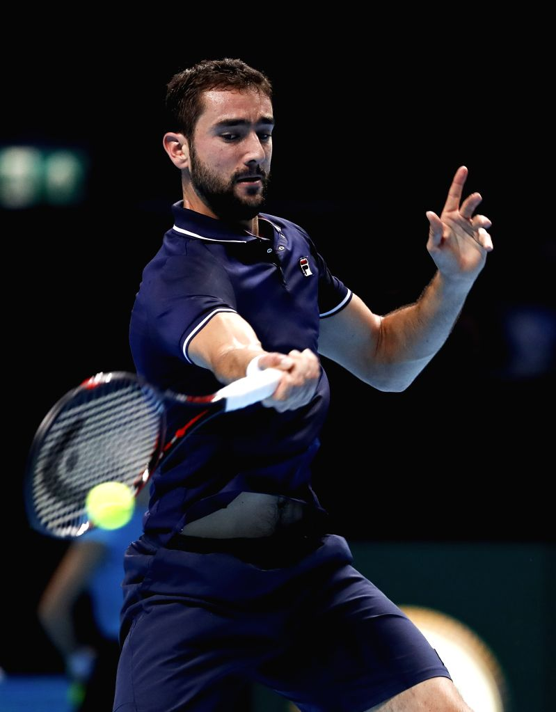 LONDON, Nov. 17, 2016 - Marin Cilic of Croatia competes in the group match with Stan Wawrinka of Switzerland at the 2016 ATP World Tour Final at O2 Arena in London, Britain, on Nov. 16, 2016. Stan ...