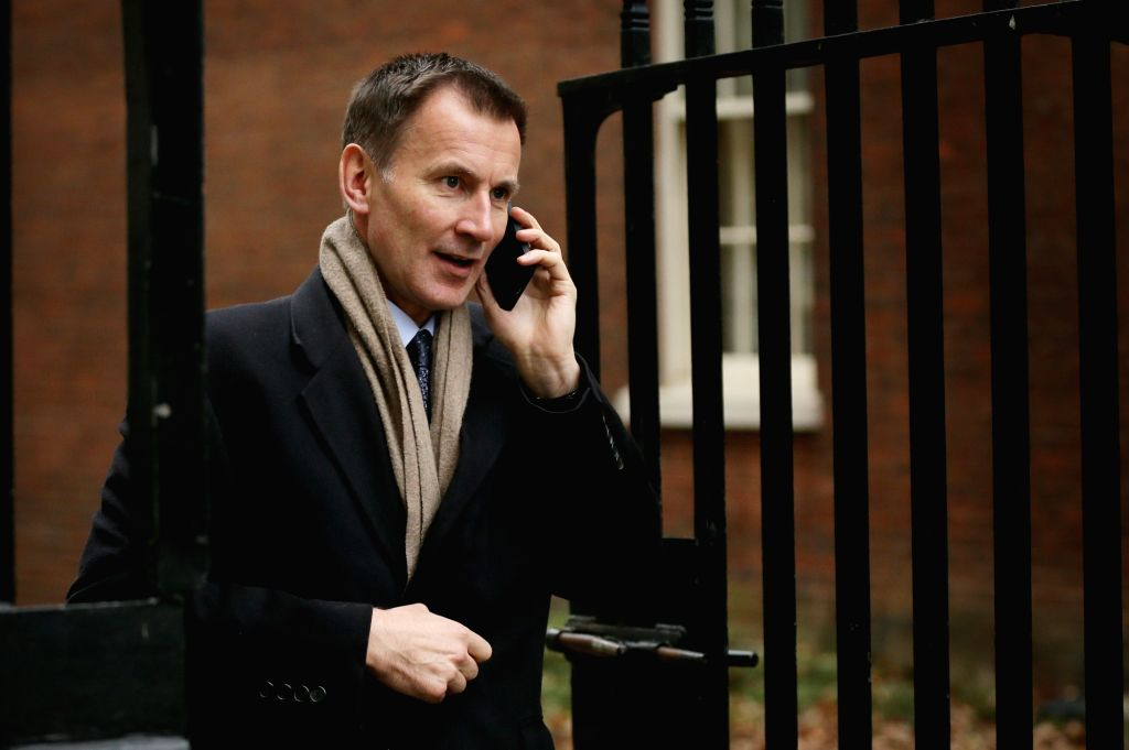 LONDON, Nov. 26, 2018 (Xinhua) -- British Foreign Secretary Jeremy Hunt arrives at 10 Downing Street for a cabinet meeting in London, Britain, on Nov. 26, 2018. The British parliament's vote on Brexit deal is expected to be held on Dec. 11, British P - Theresa May