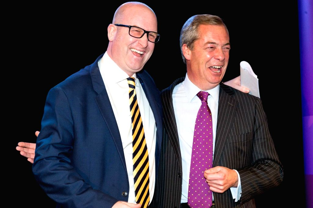 LONDON, Nov. 28, 2016 - Outgoing UKIP leader Nigel Farage(R) congratulates newly elected Paul Nuttall on Nov. 28, 2016, in London, Britain. Member of European Parliament (MEP) Paul Nuttall was named ...