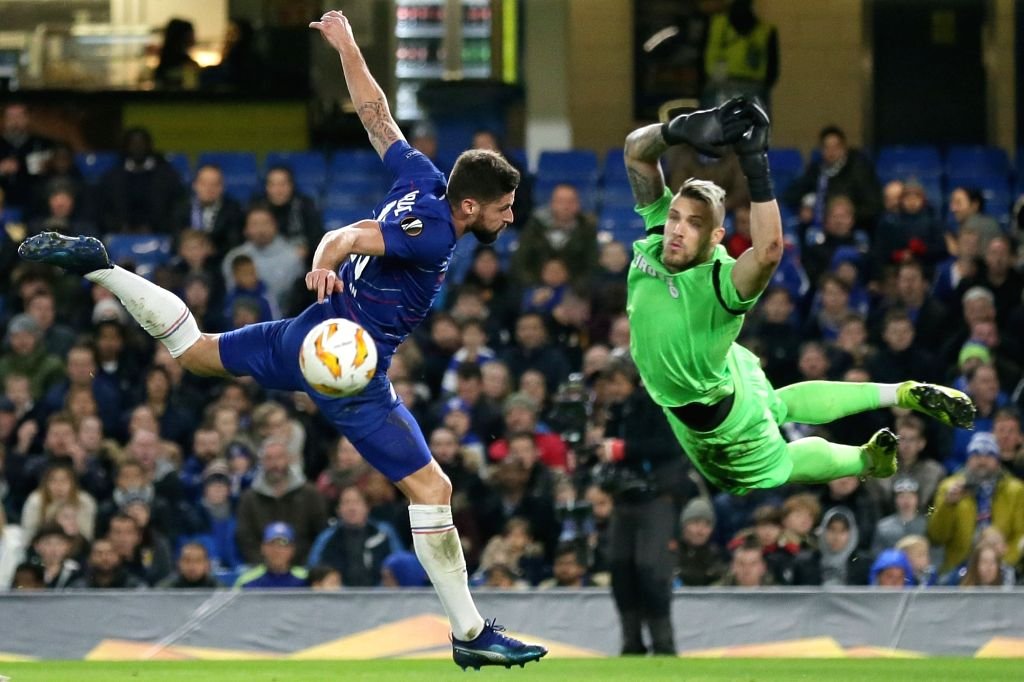 LONDON, Nov. 30, 2018 - Chelsea's Olivier Giroud (L) competes for a header during the UEFA Europa League Group L match between Chelsea and PAOK at Stamford Bridge in London, Britain on Nov. 29, 2018. ...