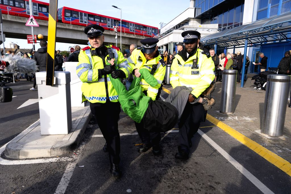 LONDON, Oct. 11, 2019 - An Extinction Rebellion protestor is arrested by police at City Airport in London, Britain, on Oct. 10, 2019.