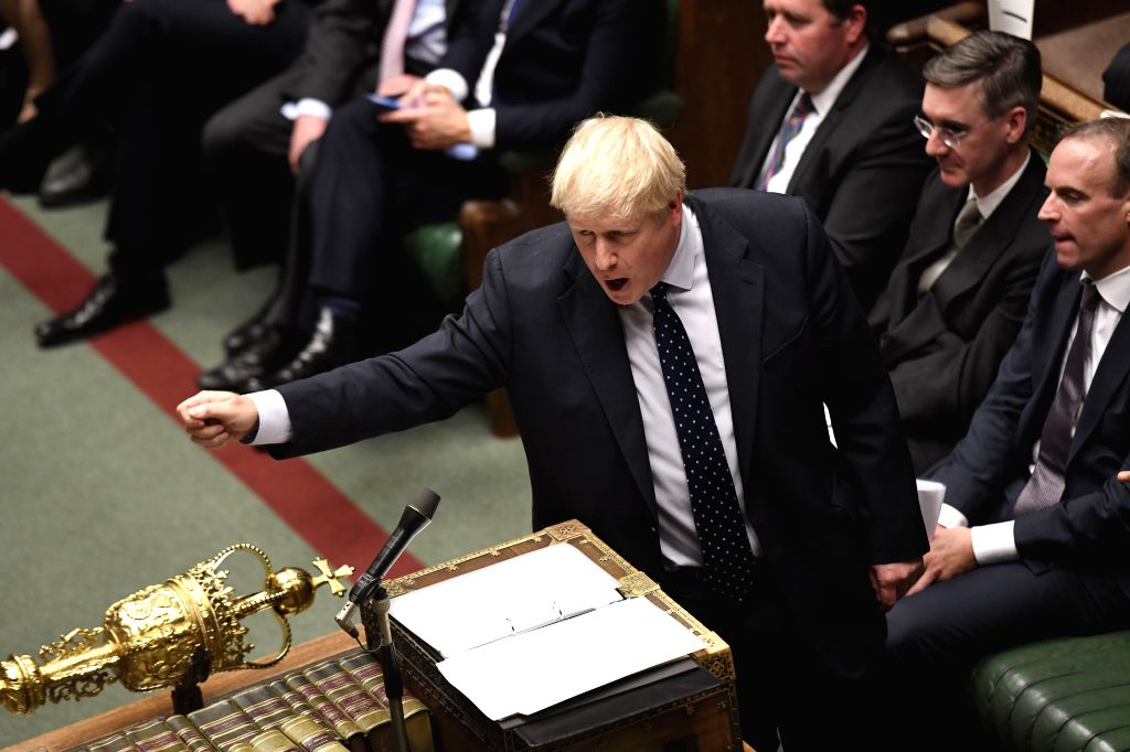LONDON, Oct. 14, 2019 (Xinhua) -- British Prime Minister Boris Johnson (front) attends the debate of the Queen's Speech at the House of Commons in London, Britain, on Oct. 14, 2019. British Queen Elizabeth II opened a new session of the British parli - Boris Johnson
