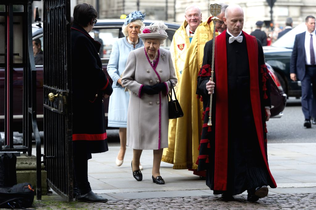 LONDON, Oct. 15, 2019 - British Queen Elizabeth II (C) arrives to attend a service marking the 750th anniversary of the rebuilding of Westminster Abbey in London, Britain, on Oct. 15, 2019.
