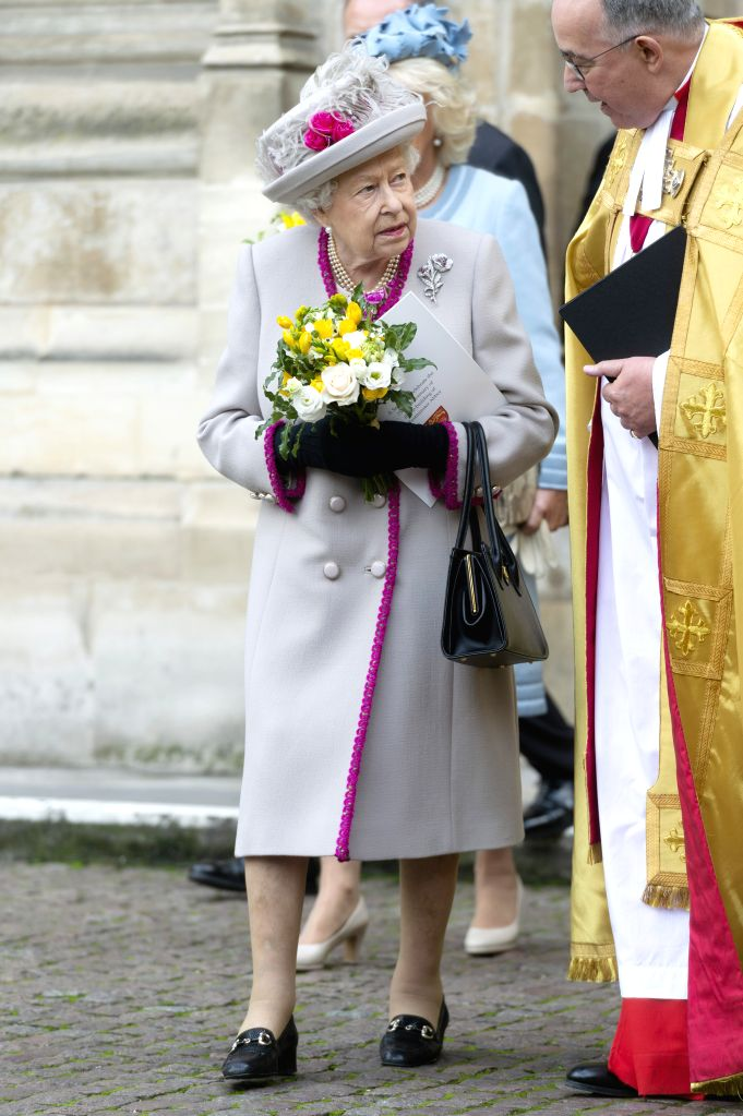 LONDON, Oct. 15, 2019 - British Queen Elizabeth II (L) departs after attending a service marking the 750th anniversary of the rebuilding of Westminster Abbey in London, Britain, on Oct. 15, 2019.