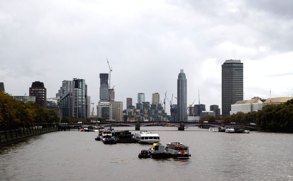 LONDON, Oct. 18, 2019 - Photo taken on Oct. 17, 2019 shows buildings by the River Thames in central London, Britain. The European Union and Britain have reached a new Brexit deal, President of the ...