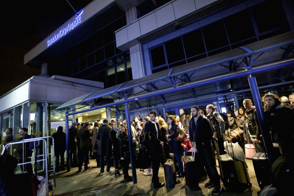 LONDON, Oct. 21, 2016 - Passengers wait outside London City Airport after it was reopened following an evacuation due to a suspected chemical incident, in London, Britain on Oct. 21, 2016. The London ...