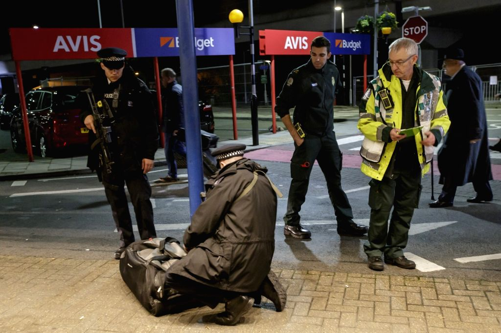 LONDON, Oct. 21, 2016 - Police check a bag outside London City Airport after it was reopened following an evacuation due to a suspected chemical incident, in London, Britain on Oct. 21, 2016. The ...