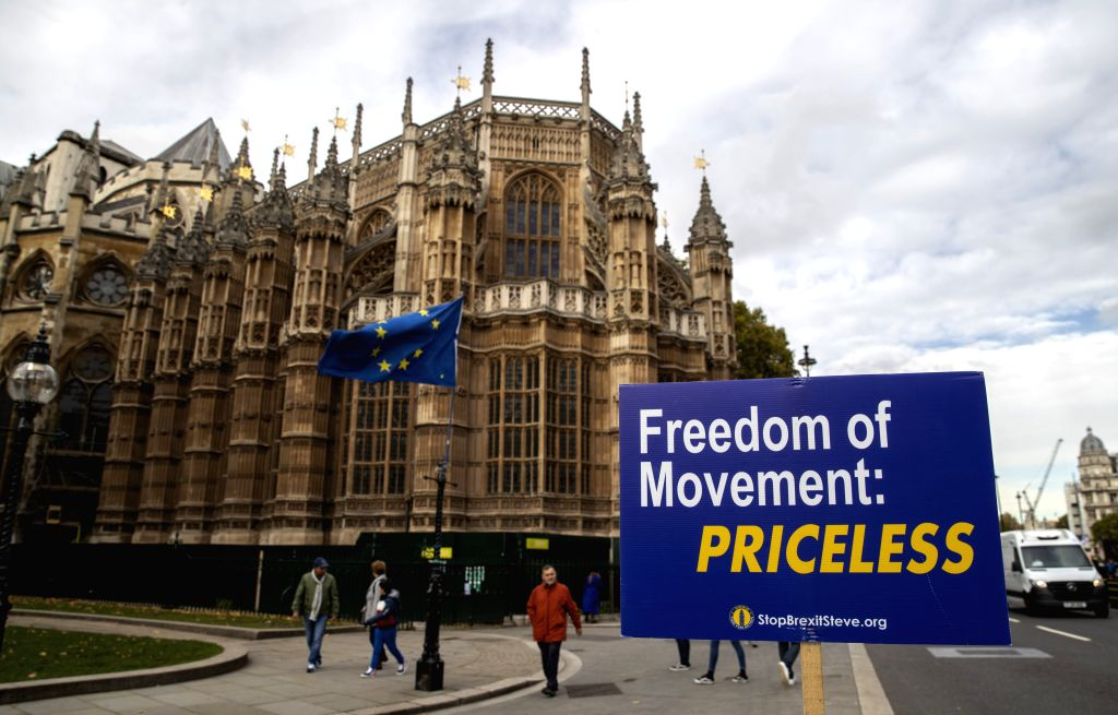 LONDON, Oct. 28, 2019 - Photo taken on Oct. 28, 2019 shows an anti-Brexit placard outside the Houses of Parliament in London, Britain. The British House of Commons on Monday voted against a ...