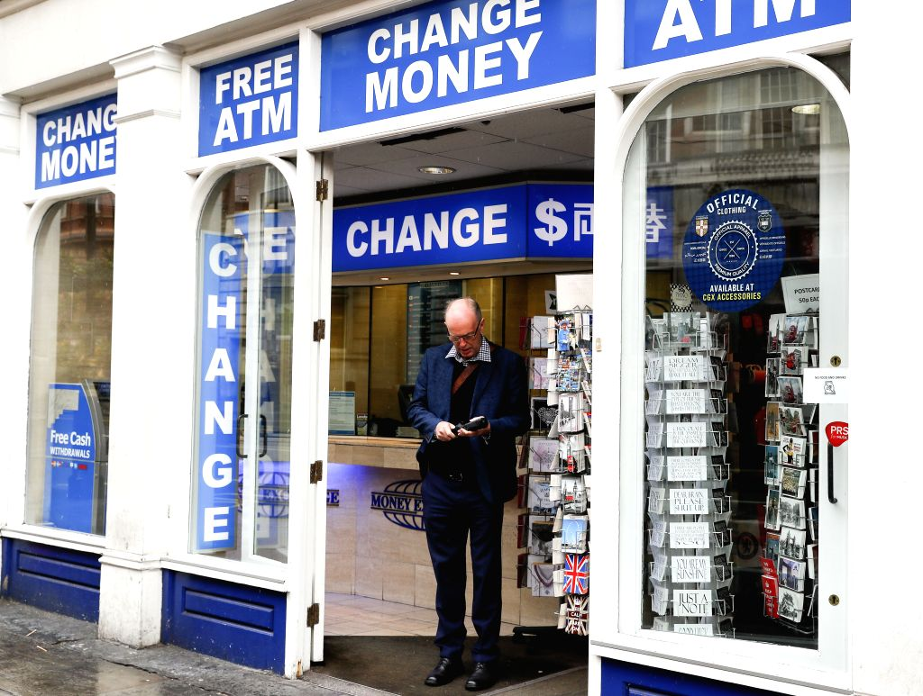LONDON, Oct. 8, 2016 - A man walks out of a money change bureau in central London, Britain, on Oct. 8, 2016. The Bank of England (BOE) Friday asked the Bank for International Settlements (BIS) to ...
