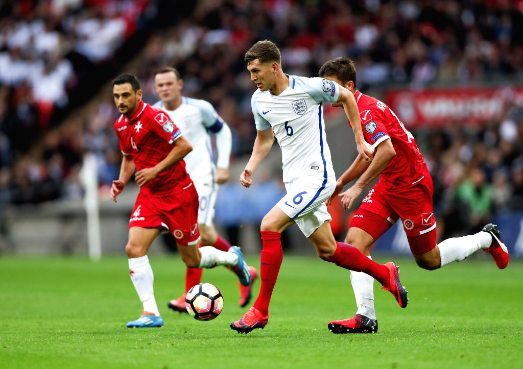 LONDON, Oct. 9, 2016 - John Stones (2nd, R) of England breaks through during the Group F match between England and Malta at 2018 FIFA World Cup European Zone Qualifiers at Wembley Stadium in London, ...