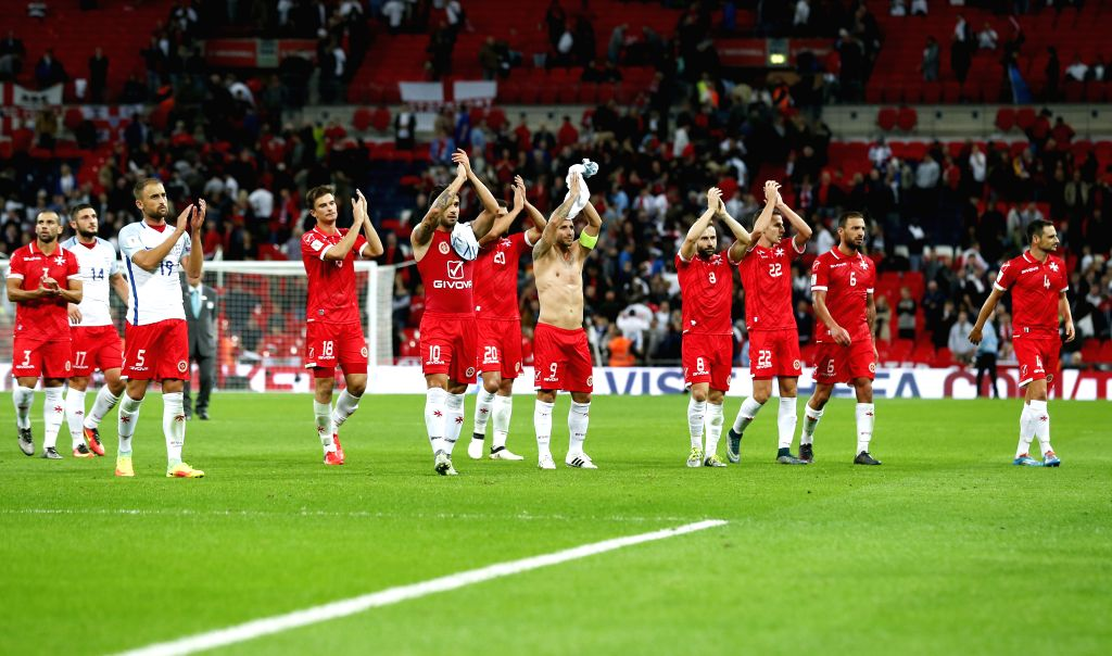 LONDON, Oct. 9, 2016 - Players of Malta acknowledge their supporters after the Group F match between England and Malta at 2018 FIFA World Cup European Zone Qualifiers at Wembley Stadium in London, ...