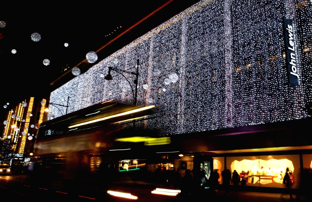 Photo taken on Nov. 19, 2014 shows the Christmas illuminations of John Lewis at Oxford Street, in London, Britain.