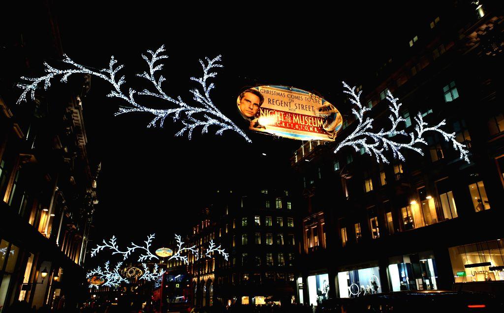 Photo taken on Nov. 19, 2014 shows the Christmas illuminations at Regent Street, in London, Britain.